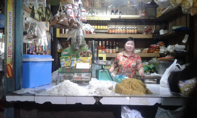 Lady at the market selling noodles